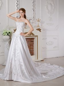 Breathtaking A-line Sweetheart Court Train Satin Dress for Brides with Appliques