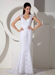 Multi-tiered Mermaid V-neck Brush Train Wedding Dresses in Lace with Beading
