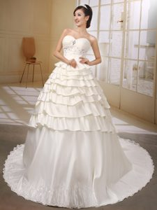 Attractive Sweetheart Beaded and Ruffled Satin Fall Wedding Dress in Ivory