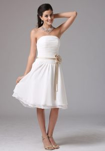 White Strapless Knee-length Ruched Dama Dress with Brown Sash and Flower