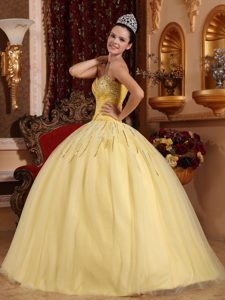 Luxurious Ruched and Beaded Lace-up Dress for Quinceanera in Light Yellow