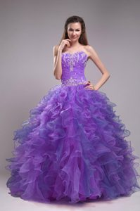 Romantic Appliqued Lavender Quinceanera Dress with Beading and Ruffles