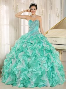 Stylish Apple Green Beaded Lace-up Quinces Dress with Ruffles to Floor-length