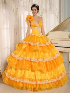 One Shoulder Yellow Organza Sweet 16 Dress with Layered Ruffles and Flower