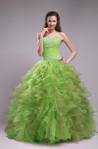 Sweetheart Yellow Green Ruched Quinceanera Dress with Ruffles and Beading