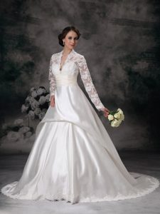Affordable Plunging Prom Wedding Dress in Lace and with Long Sleeves