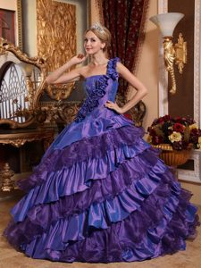 Dark Purple One Shoulder Quinceanera Dress with Layered Ruffles and Flowers