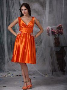 V-neck Knee-length Ruched Bridesmaid Dress in Orange Red