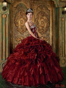 Wine Red Ball Gown Strapless Quinceanera Dress with Ruffles and Beadings