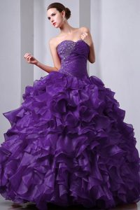 Purple Uptown Sweetheart Quinces Dresses in Organza with Beading and Ruffles