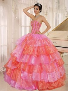 Breathtaking Pink and Orange Dress for Quince with Ruffled Layers and Appliques